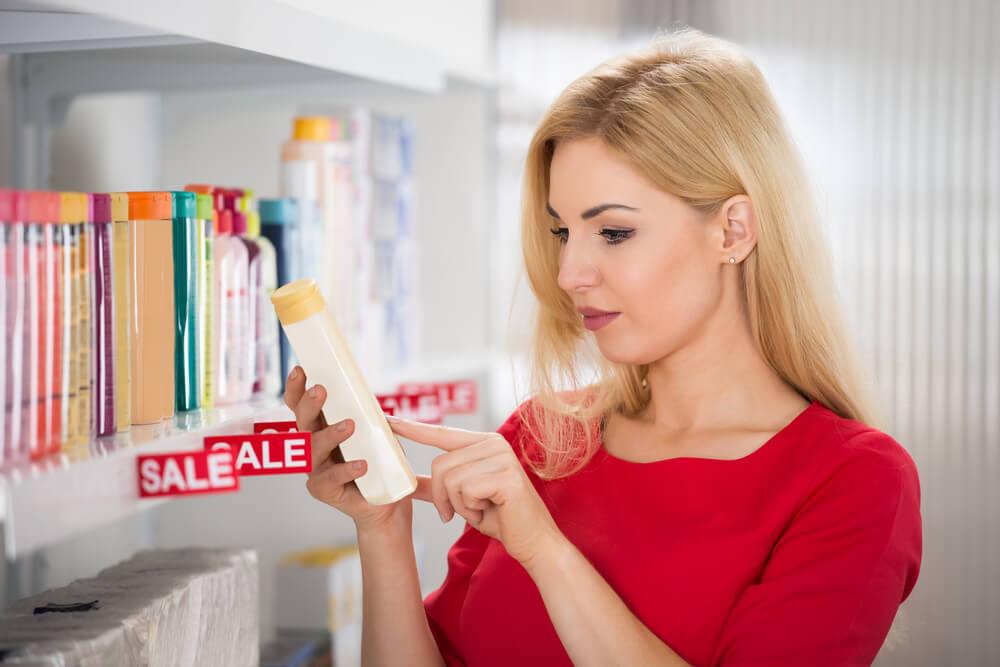Female customer reading label on bottle