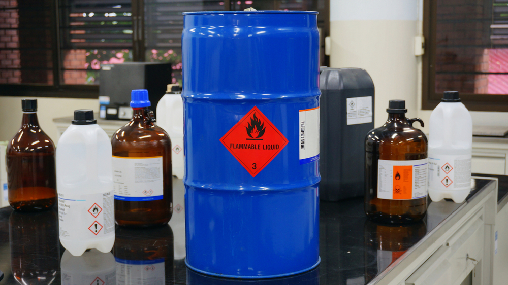 Various hazardous materials labels on many containers